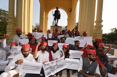 Lucknow: Samajwadi Party (SP) activists stage a demonstration against the alleged rape of an 18-year-old by Unnao MLA Kuldeep Singh Senger, in Lucknow on April 10, 2018. (Photo: IANS)