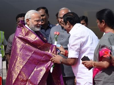 Chennai: Prime Minister Narendra Modi being welcomed by the Governor of Tamil Nadu, Banwarilal Purohit and the Chief Minister of Tamil Nadu Edappadi K. Palaniswami, on his arrival, at Chennai, Tamil Nadu on April 12, 2018. (Photo: IANS/PIB)