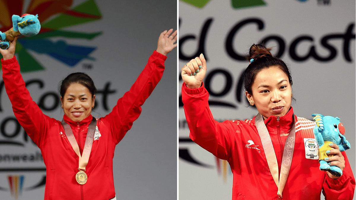 Mirabai Chanu (right) and Sanjita Chanu (left) after clinching gold at the Gold Coast Commonwealth Games.