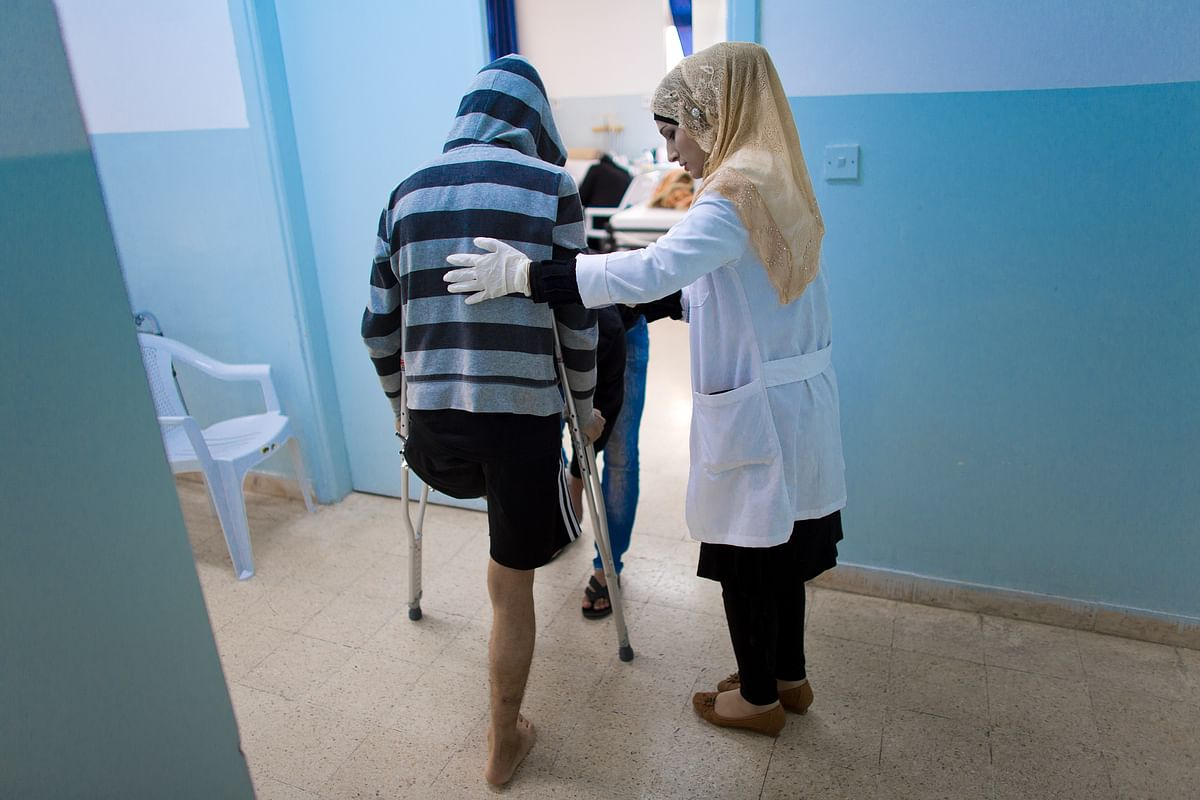 """""""It takes four hands just to transfer a patient to the bed. There are many patients, and not enough hands""""."""