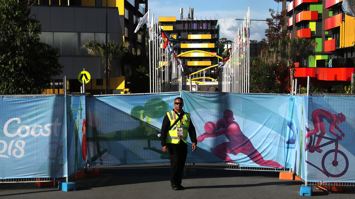 A police officer stands guard at the Commonwealth Games village in Gold Coast.