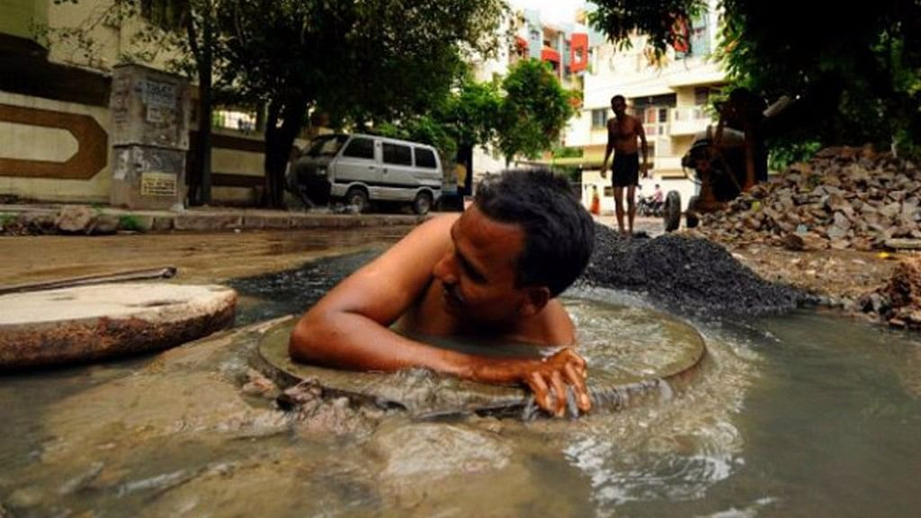 Manual scavenging was banned by law in India, yet continues with few checks. Representative image.