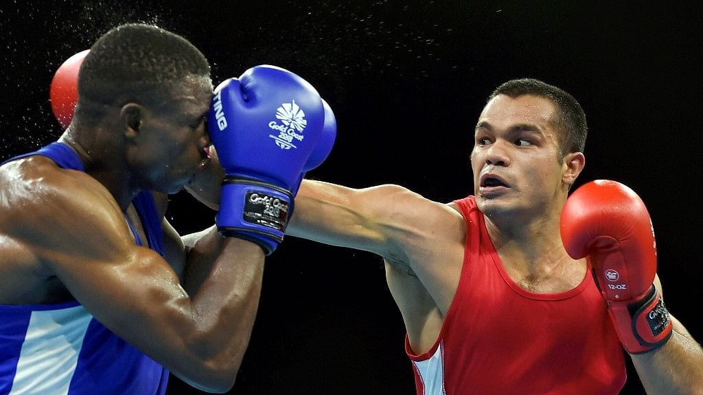 India's Vikas Krishan Yadav and Zambias Benny Muziyo compete in the Mens 75kg category quarterfinals boxing bout at the Commonwealth Games 2018.