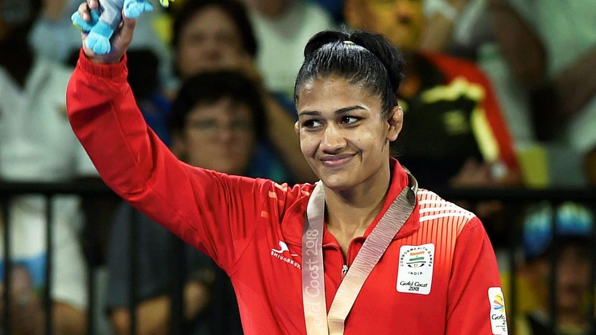 Babita Kumari stands on the podium after winning a silver medal at CWG 2018.