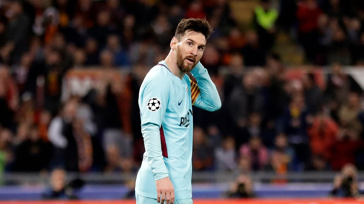 Barcelona's Lionel Messi reacts after missing a scoring chance during the Champions League quarterfinal second leg soccer match between Roma and FC Barcelona at Rome's Olympic Stadium, Tuesday, April 10, 2018.