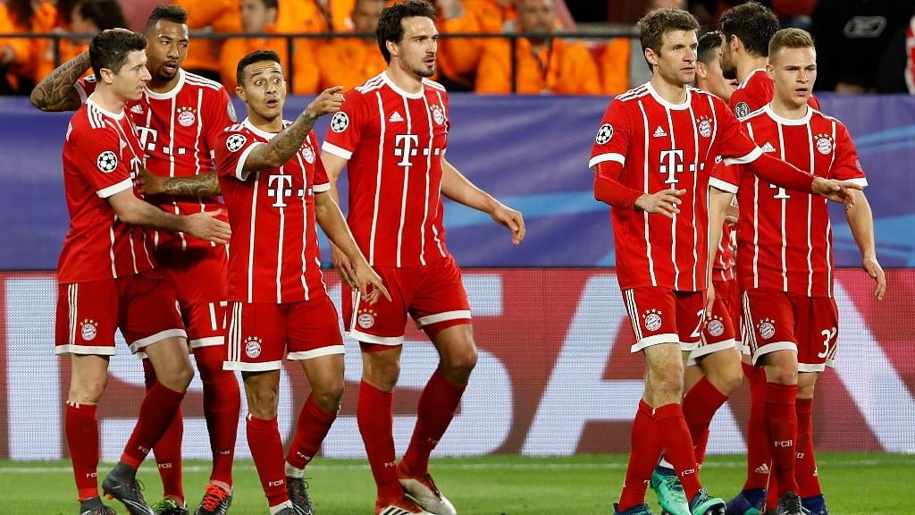 Bayern Munich's players celebrate with teammates after scoring his side's second goal during the first leg Champions League quarterfinal match against Sevilla FC at the Sanchez Pizjuan stadium in Seville last week.