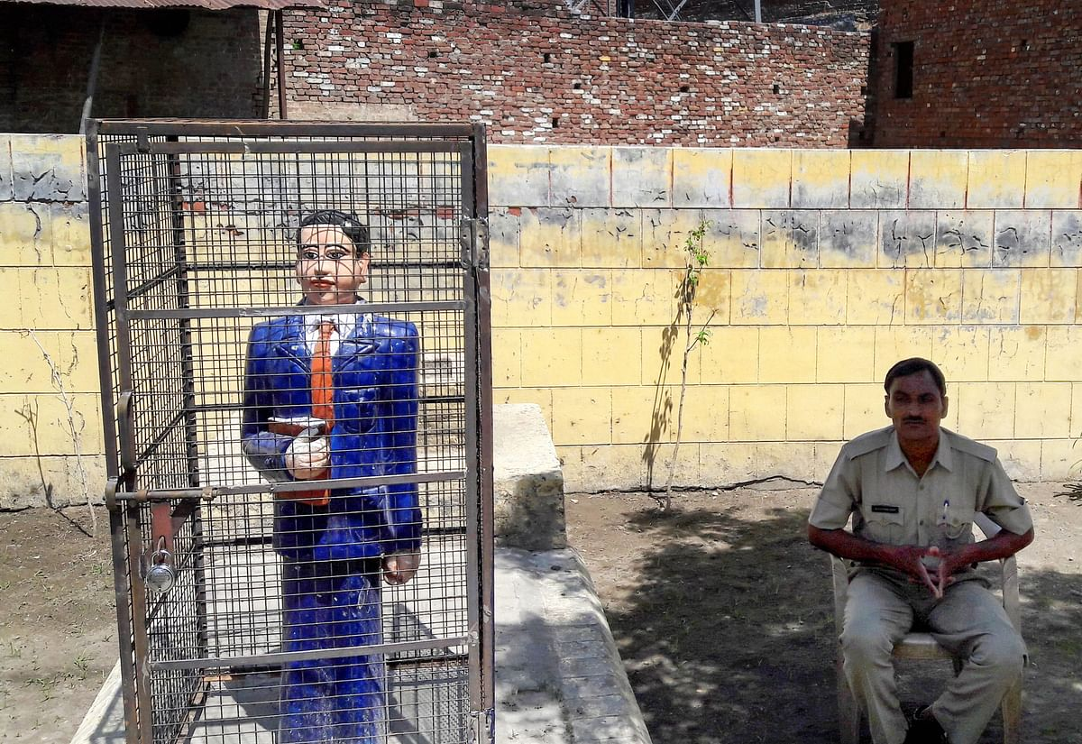 A statue of Dr Bhimrao Ambedkar locked in an iron cage, in Badaun on Thursday. A statue of the leader recently raised controversy after it was painted in saffron.