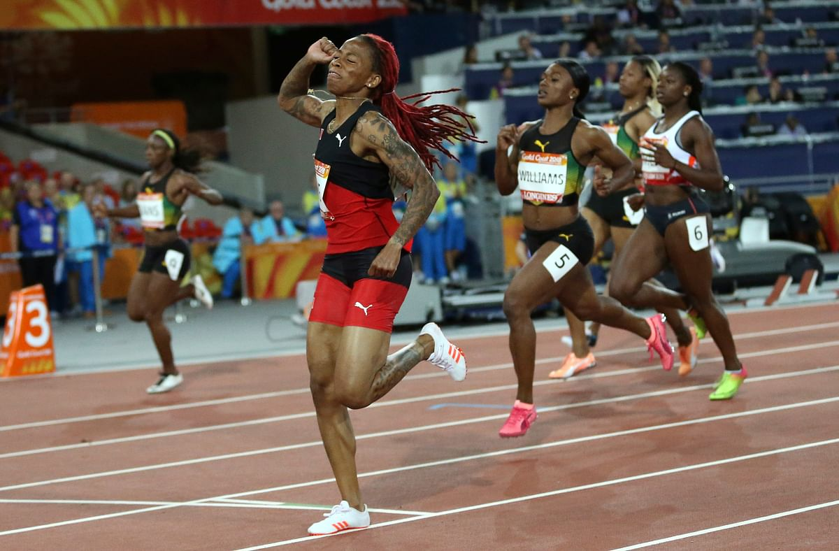 Michelle-Lee Ahye of Trinidad and Tobago crosses the finish line to win the women's 100m final at Carrara Stadium during the Commonwealth Games on the Gold Coast, Australia, Monday, April 9, 2018.