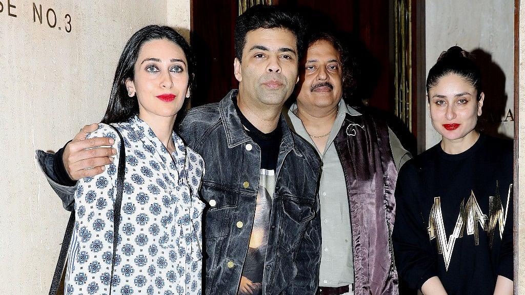 Kareena Kapoor, Karisma Kapoor and Karan Johar pose while exiting Manish Malhotra's house.