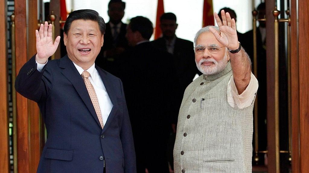 India's Prime Minister Narendra Modi (right) and China's President Xi Jinping.