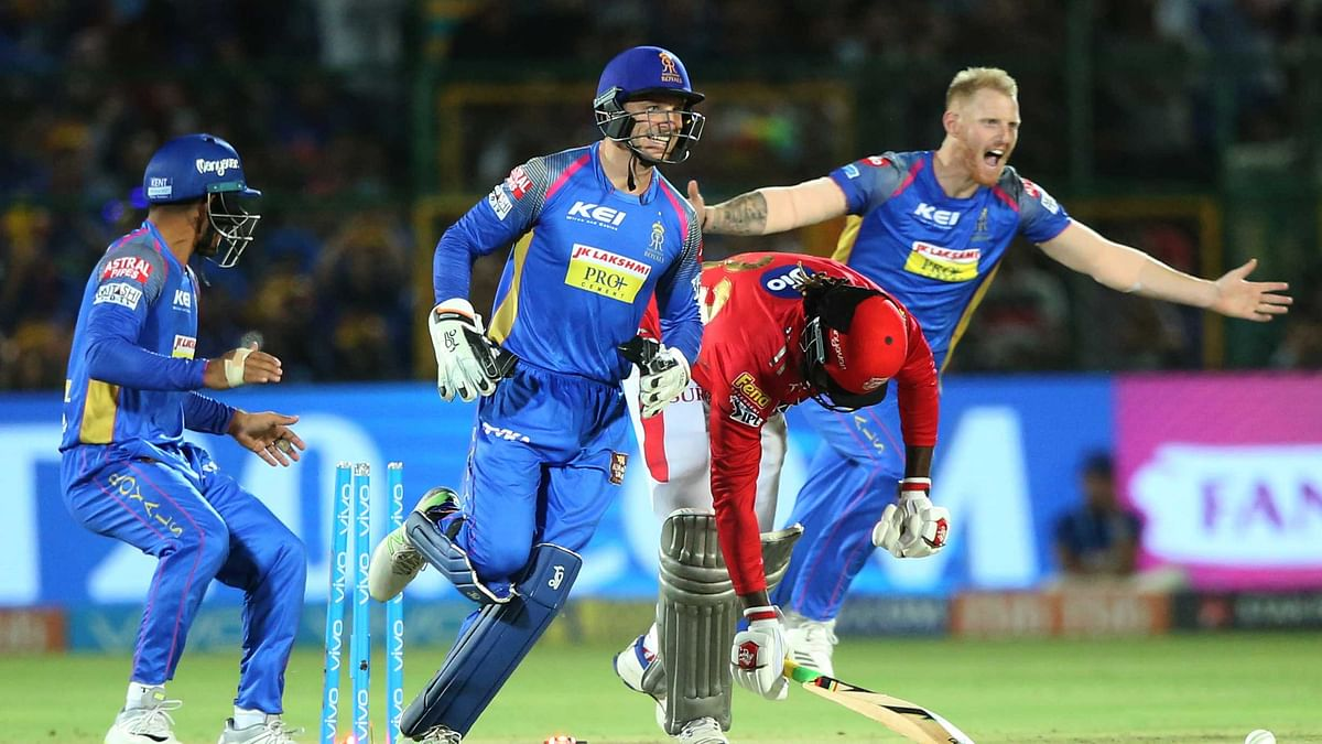 Rajasthan Royals players celebrate the wicket of Chris Gayle in the third over of the Kings XI Punjab chase.