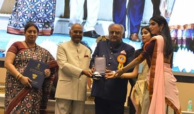 New Delhi: Filmmaker Boney Kapoor along with his daughters Janhvi and Khushi Kapoor, receives National Film Award from President Ram Nath Kovind on the behalf of his wife and late actress Sridevi, during 65th National Film Awards, in New Delhi on May 3, 2018. Also seen Union Ministers Smriti Irani and Rajyavardhan Singh Rathore. (Photo: IANS)