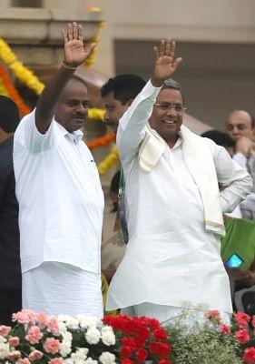 Bengaluru: Karnataka Chief Minister H.D. Kumaraswamy with Congress leader Siddaramaiah during his swearing-in ceremony at Vidhana Soudha in Bengaluru on May 23, 2018. (Photo: IANS)