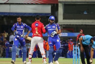Indore: Krunal Pandya and Rohit Sharma of Mumbai Indians after winning an IPL 2018 match against Kings XI Punjab at Holkar Cricket Stadium in Indore on May 4, 2018. (Photo: IANS)