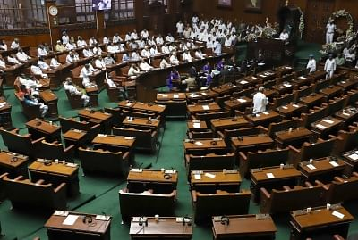 Bengaluru: Karnataka BJP legislators walk out of the state assembly ahead of the trust vote moved by Chief Minister H.D. Kumaraswamy in the House, in Bengaluru on May 25, 2018. (Photo: IANS)
