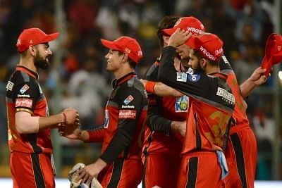 Bengaluru: Royal Challengers Bangalore players celebrate after winning an IPL 2018 match against Mumbai Indians at M. Chinnaswamy Stadium in Bengaluru, on May 1, 2018. (Photo: IANS)