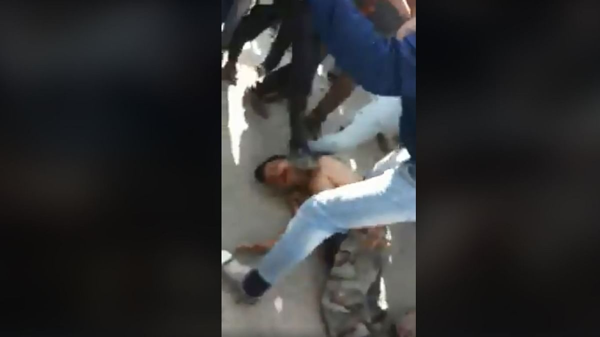 Visuals from the video where the soldier is being beaten up by the mob.