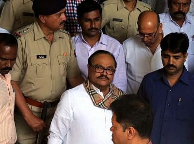 Mumbai: NCP leader Chhagan Bhujbal who was arrested by the Enforcement Directorate in connection with corruption cases lodged against him being taken to be produced at a Mumbai court, on March 15, 2016. (Photo: IANS)