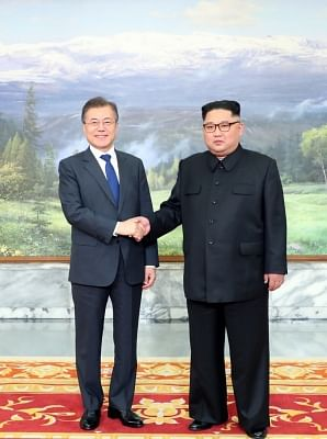 Panmunjom: This photo released by Cheong Wa Dae shows South Korean President Moon Jae-in (L) shaking hands with North Korean leader Kim Jong-un ahead of their summit at Tongilgak on the northern side of Panmunjom in the Demilitarized Zone on May 26, 2018.(Yonhap/IANS)
