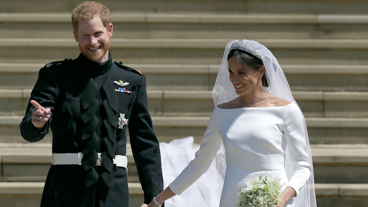 Prince Harry and Meghan Markle greet fans.