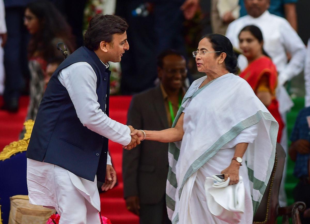 Akhilesh and Mamata share a handshake.