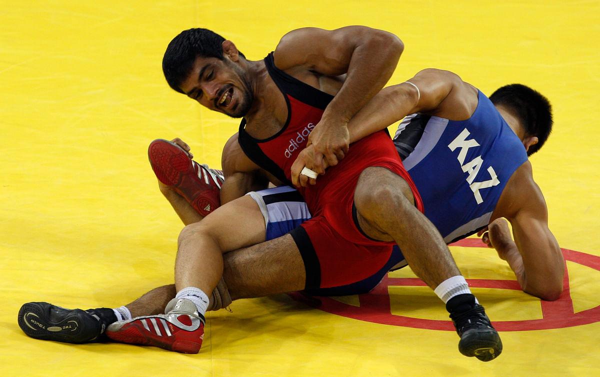 Sushil Kumar fights Leonid Spiridonov of Kazakhstan during their 66 kg men's freestyle wrestling bronze medal match at the Beijing Olympic Games.