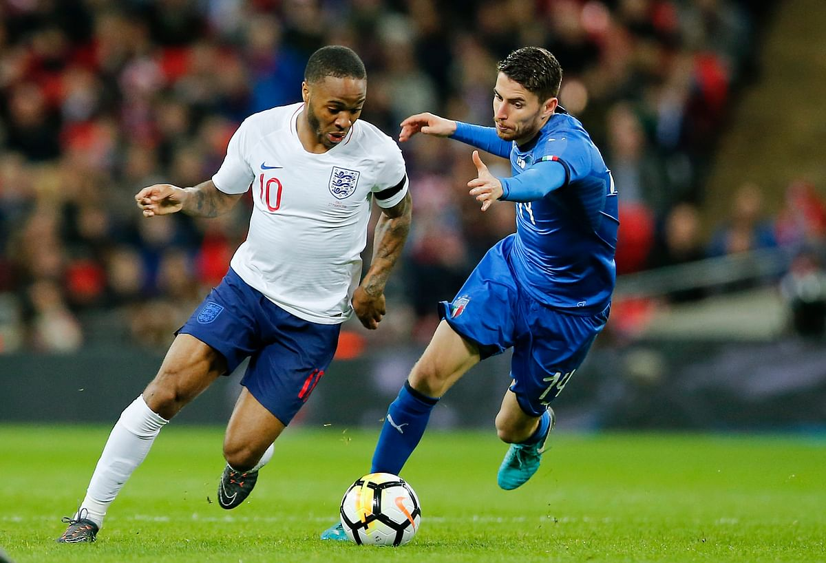 In this Tuesday, March 27, 2018 filer, England's Raheem Sterling, left, and Italy's Jorginho vie for the ball during the international friendly soccer match between England and Italy at the Wembley Stadium in London.