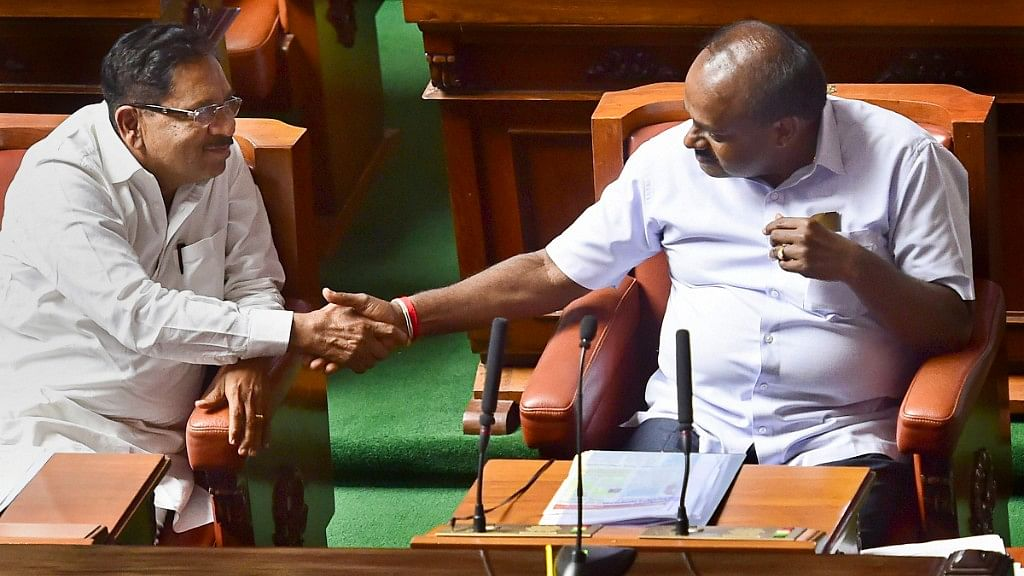 Karnataka Chief Minister HD Kumaraswamy and his deputy, G Parameshwara, greet each other after their coalition government won the trust vote.