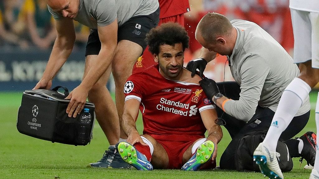 Liverpool's Mohamed Salah gets medical treatment during the Champions League Final