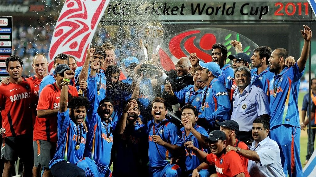 Indian cricket team pose after 2011 cricket world cup victory.