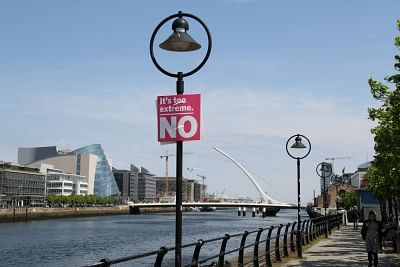 DUBLIN, May 26, 2018 (Xinhua) -- A pregnant woman passes by a lamp poster against legalized abortion along River Liffey in downtown Dublin, Ireland, May 25, 2018. Nearly 70 percent of Irish voted to abolish Ireland
