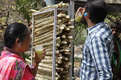 People quench their thirst with sugarcane juice on a hot day. (File Photo: IANS)