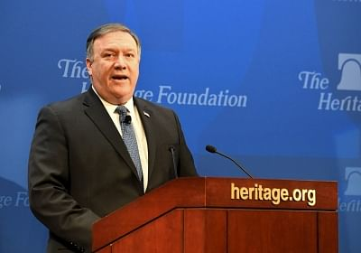 WASHINGTON, May 21, 2018 (Xinhua) -- U.S. Secretary of State Mike Pompeo delivers a speech regarding U.S. policy after withdrawing from Iran nuclear deal at the Heritage Foundation in Washington D.C., the United States, on May 21, 2018. Mike Pompeo on Monday chastised Iran for its nuke and missile programs, vowing to issue Tehran the toughest sanctions in history if it does not change course. (Xinhua/Yang Chenglin/IANS)