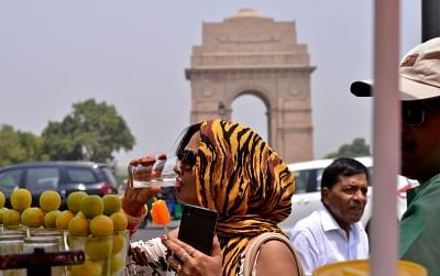 New Delhi: A woman drinks lemonade to beat the heat on a hot day in New Delhi on May 23, 2018. (Photo: IANS)