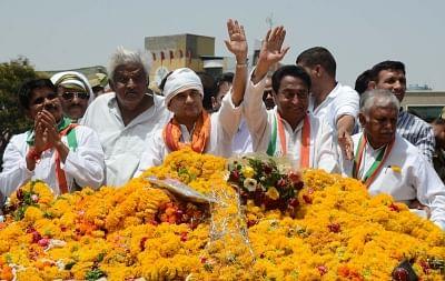 Bhopal: Congress leaders Kamal Nath and Jyotiraditya Scindia during a roadshow, in Bhopal on May 1, 2018. (Photo: IANS)