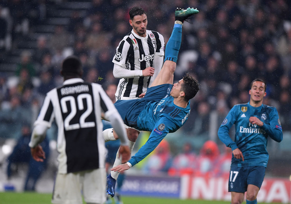 Cristiano Ronaldo score Real Madrid's second goal against Juventus in Turin in the first leg of the quarterfinals.