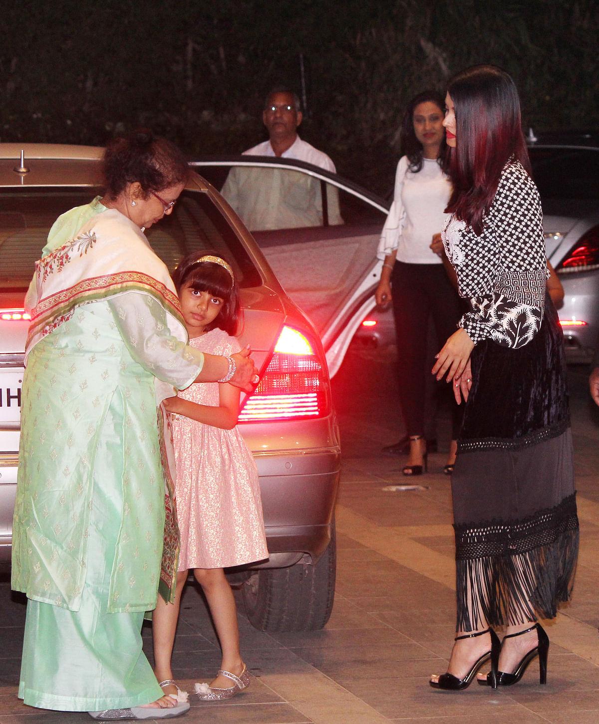 Aaradhya gives a goodbye hug to her grandmother.