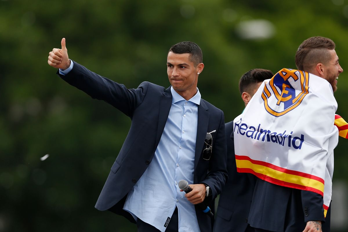 Real Madrid's Cristiano Ronaldo gestures to supporters as he celebrates with teammates at the Cibeles square in Madrid.