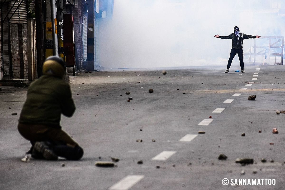 Protestor in a confrontation with the J&K police.