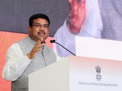 New Delhi: New Delhi: Union Minister for Petroleum & Natural Gas and Skill Development & Entrepreneurship Dharmendra Pradhan addresses at the IX CGD (City Gas Distribution) bidding round-1st Road Show, in New Delhi on May 8, 2018. (Photo: IANS/PIB)