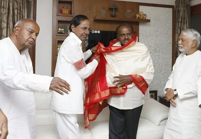 Bengaluru: Telangana Chief Minister K Chandrasekhar Rao arrives at the residence of JD(S) chief H.D. Deve Gowda on the eve of the swearing-in ceremony of Karnataka Chief Minister-designate H. D. Kumaraswamy, in Bengaluru on May 22, 2018. (Photo: IANS)