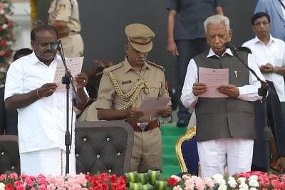 Bengaluru: Karnataka Governor Vajubhai Vala administers the oath of office to Janata Dal-Secular (JD-S) leader H.D. Kumaraswamy at Vidhana Soudha in Bengaluru on May 23, 2018. Kumaraswamy was sworn-in as the 25th Chief Minister of Karnataka. (Photo: IANS)