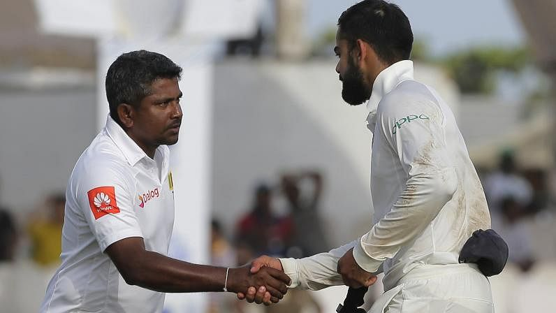 India's captain Virat Kohli, right, shakes hands with Sri Lankan captain Rangana Herath after their win in the first test cricket match in Galle.