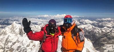 Mountaineer Arjun Vajpai (left) at the Kanchenjunga summit.