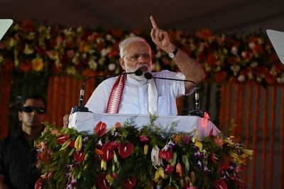Cuttack: Prime Minister Narendra Modi during a rally organised on the occasion of four years of completion of his government in Cuttack on May 26, 2018. (Photo: IANS)