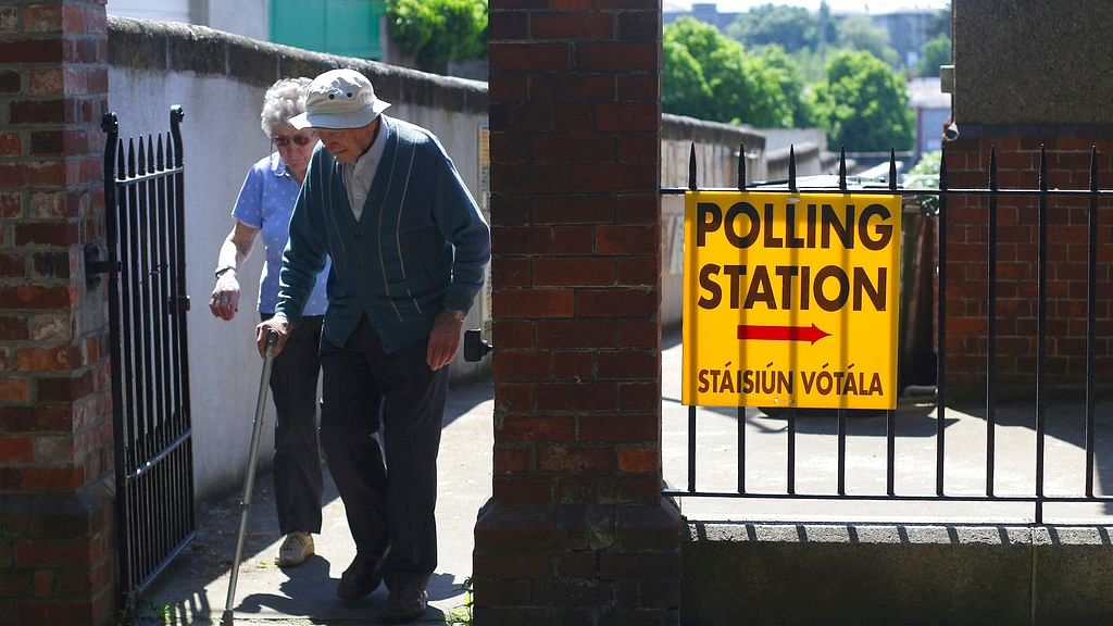A couple leave a polling station after voting in the referendum on the 8th Amendment of the Irish Constitution, in Knock, Ireland, Friday, 25 May 2018.