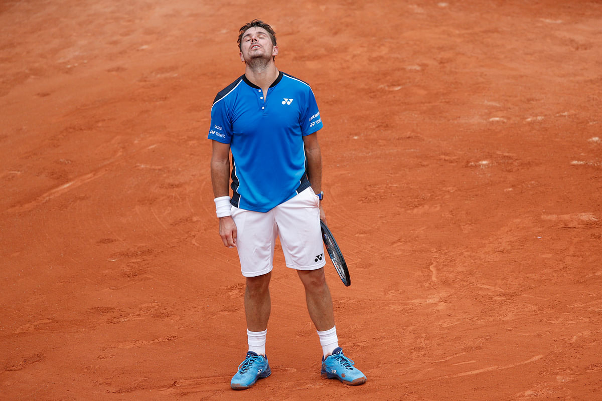 Switzerland's Stan Wawrinka misses a return against Spain's Guillermo Garcia-Lopez during their first round match of the French Open tennis tournament at the Roland Garros stadium in Paris, France, Monday, May 28, 2018. Wawrinka lost in five sets 6-2, 3-6, 4-6, 7-6 (7-5), 6-3.