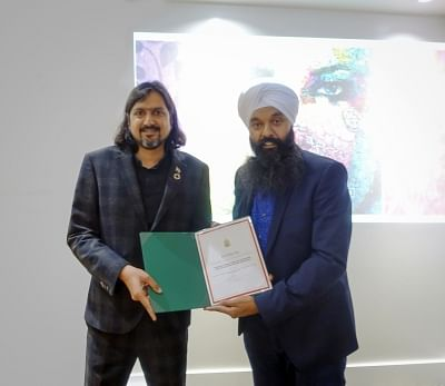 Ricky Kej Awarded Certificate of Appreciation by The Parliament - House of Commons, Canada. Presenting it is Mr. Randeep Sarai, Member of Parliament.