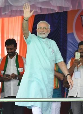Chamarajanagar: Prime Minister and BJP leader Narendra Modi during a party rally ahead of Karnataka assembly polls in Chamarajanagar, on May 1, 2018. (Photo: IANS)