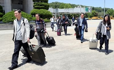 Seoul: South Korean journalists head to a plane at Seoul Airport, just southeast of Seoul, on May 23, 2018, to go to North Korea where they will cover the dismantlement of the North